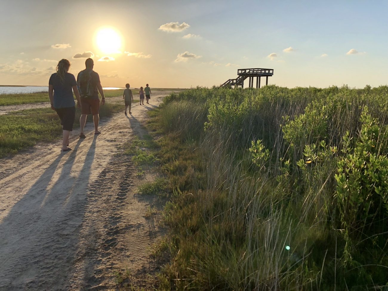 Family hikes to overlook at sunset