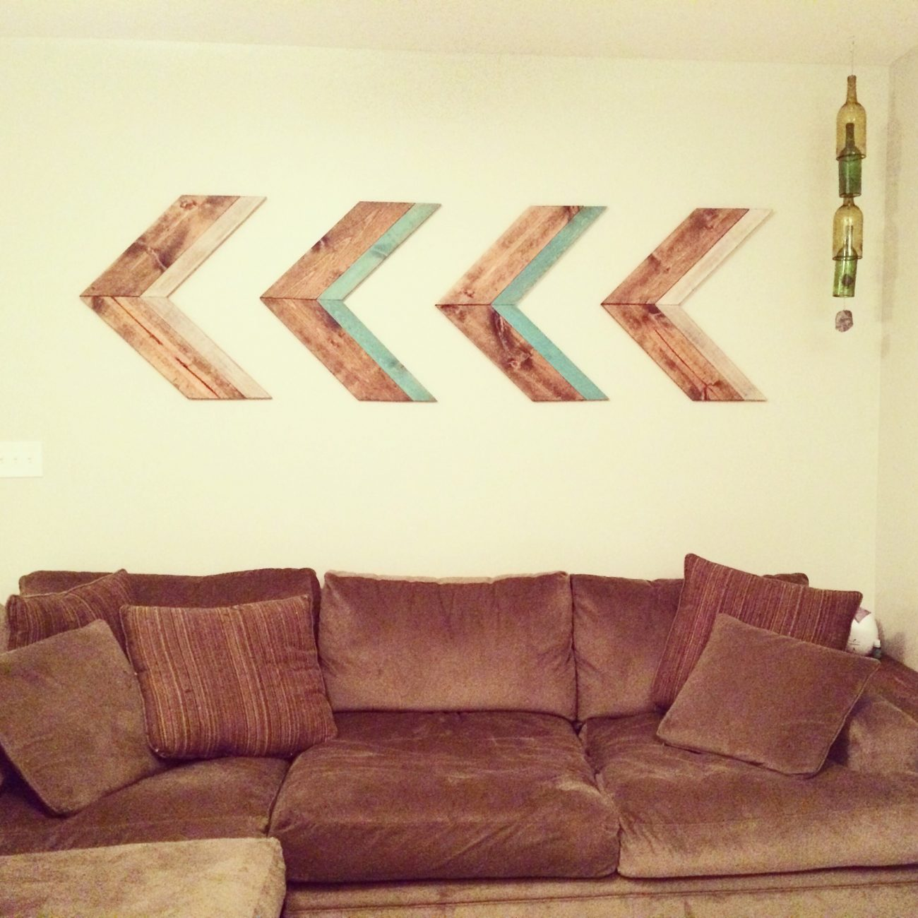 Wooden arrows above couch