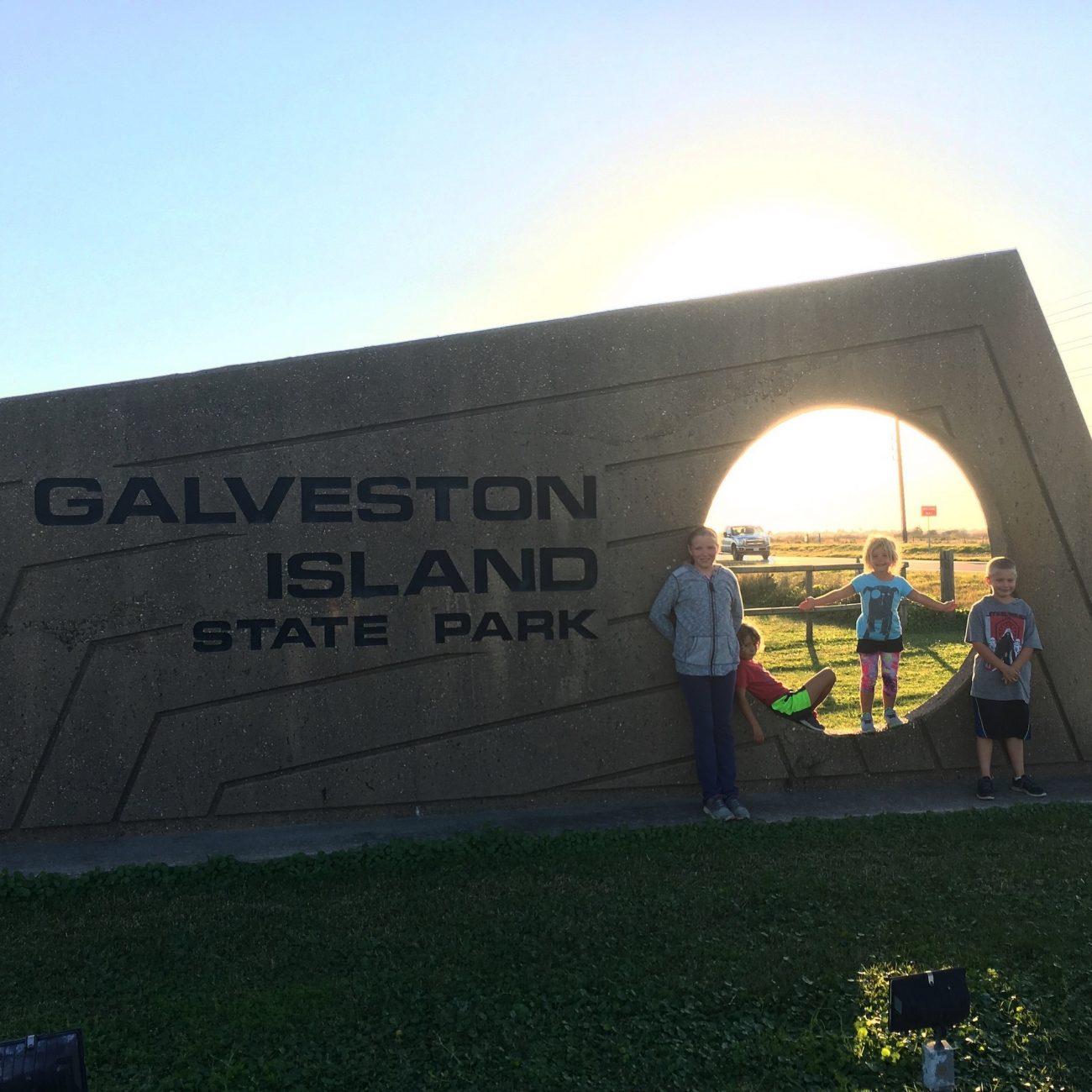 Kids at Galveston Island Sign