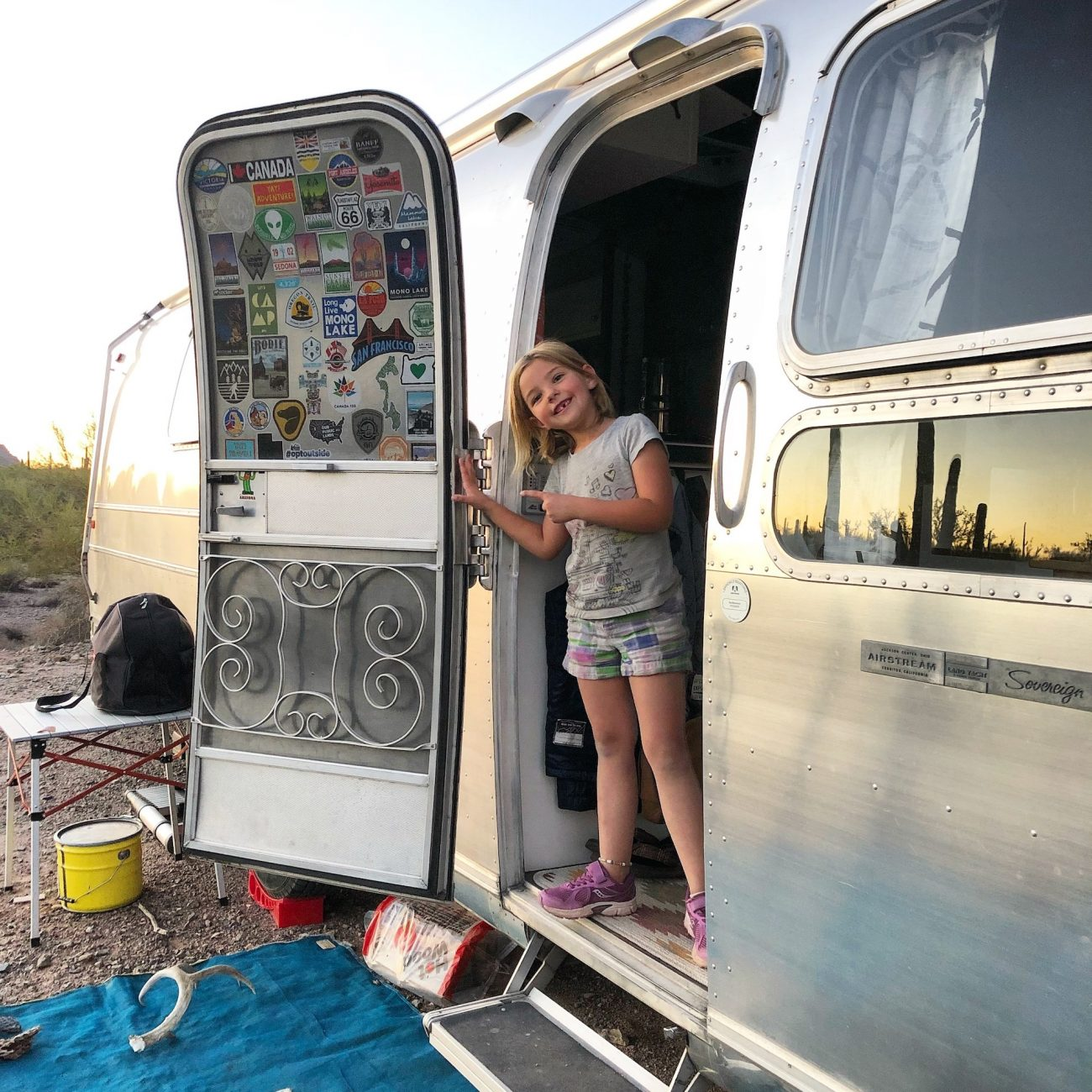 Little girl showing off missing tooth in Airstream