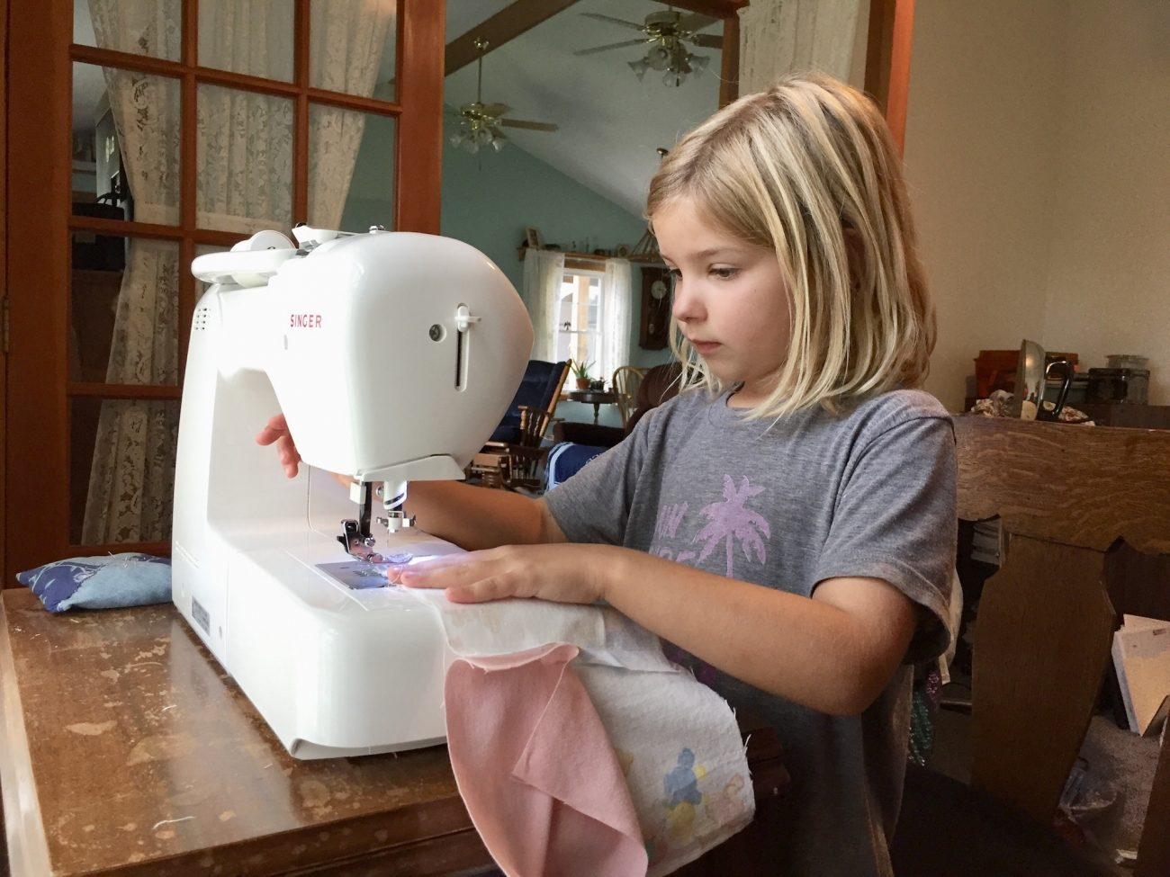 Ada learns how to sew