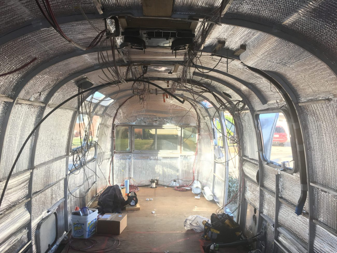 Airstream with interior walls off and 12V wiring.