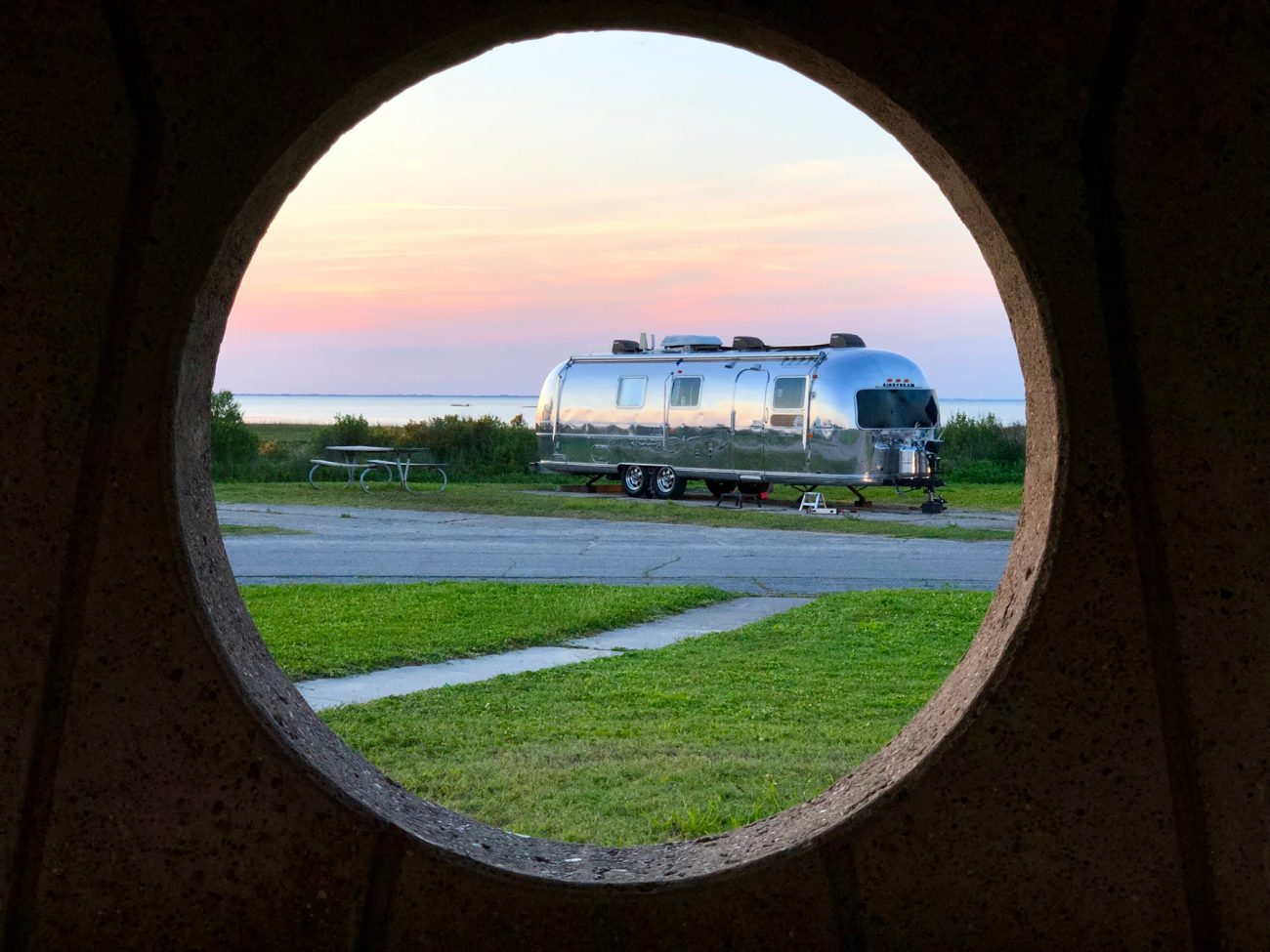 Airstream near cost at Galveston framed by circle