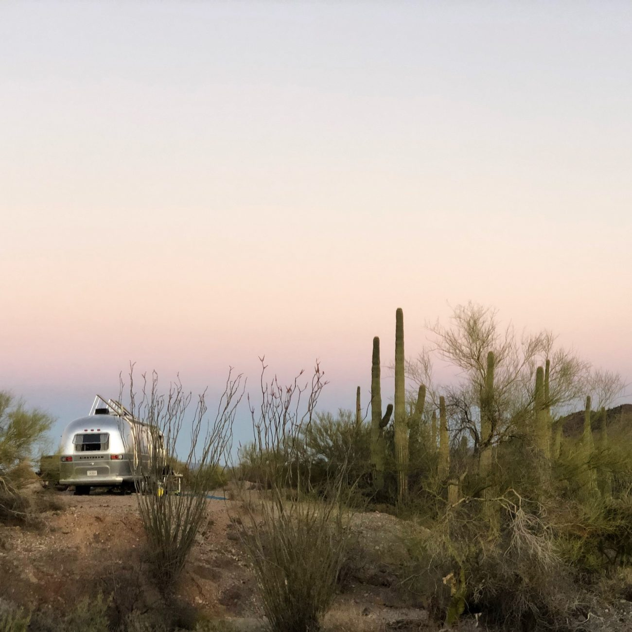 Airstream with solar panels raised at sunset in Sonoran Desert near Ajo, AZ