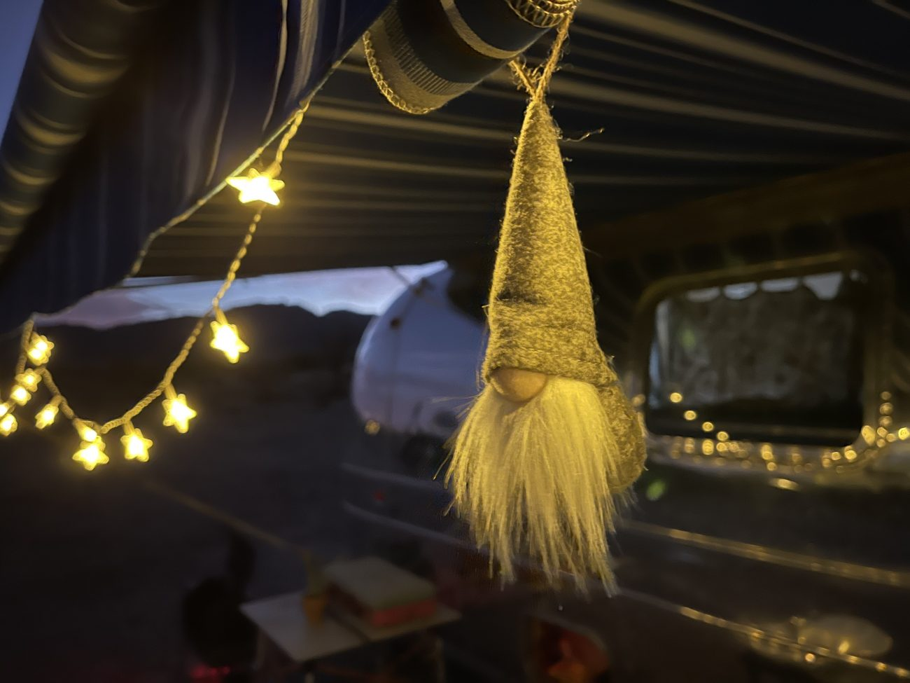 Christmas Gnome hanging from awning