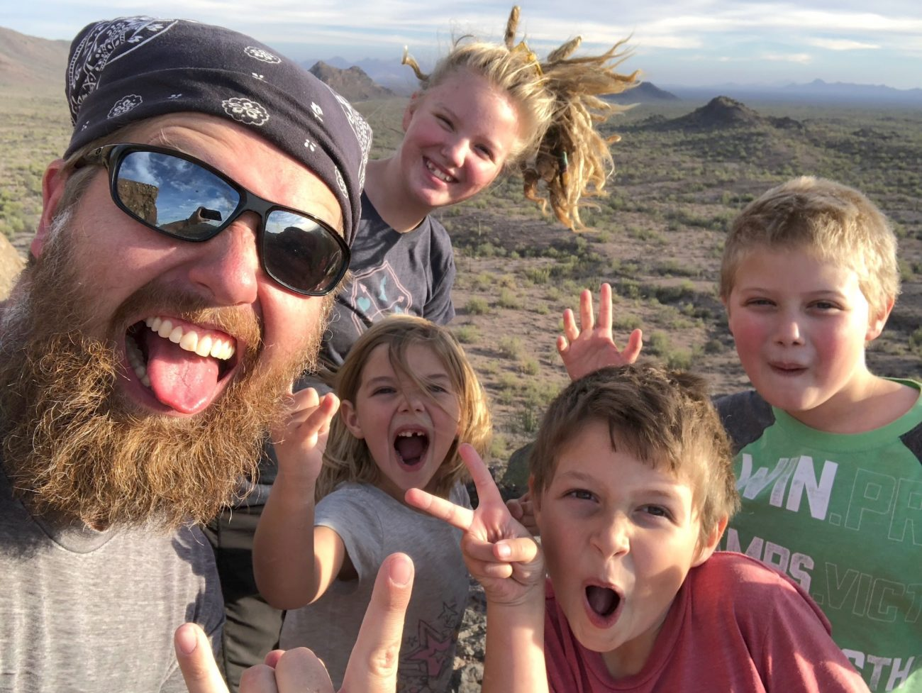 Dad and Kids selfie at the top of butt rock.