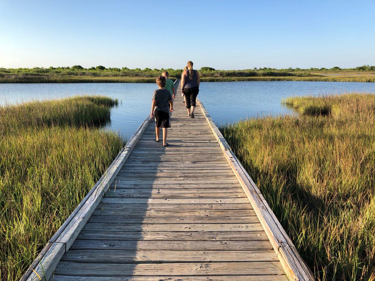 Family crossing bridge at Galveston