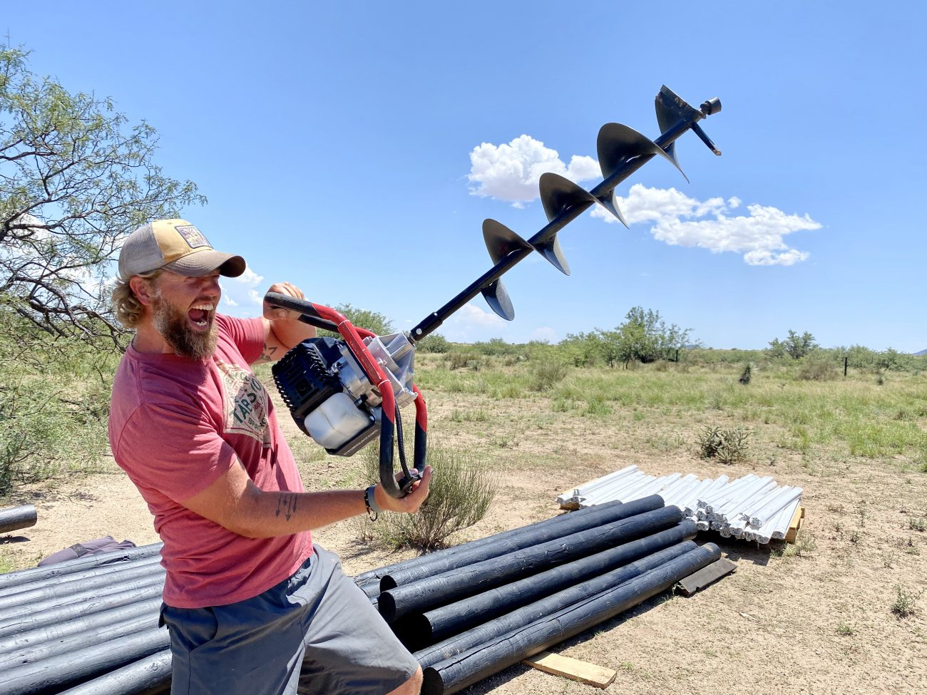 Jonathan with Auger & Fence Posts
