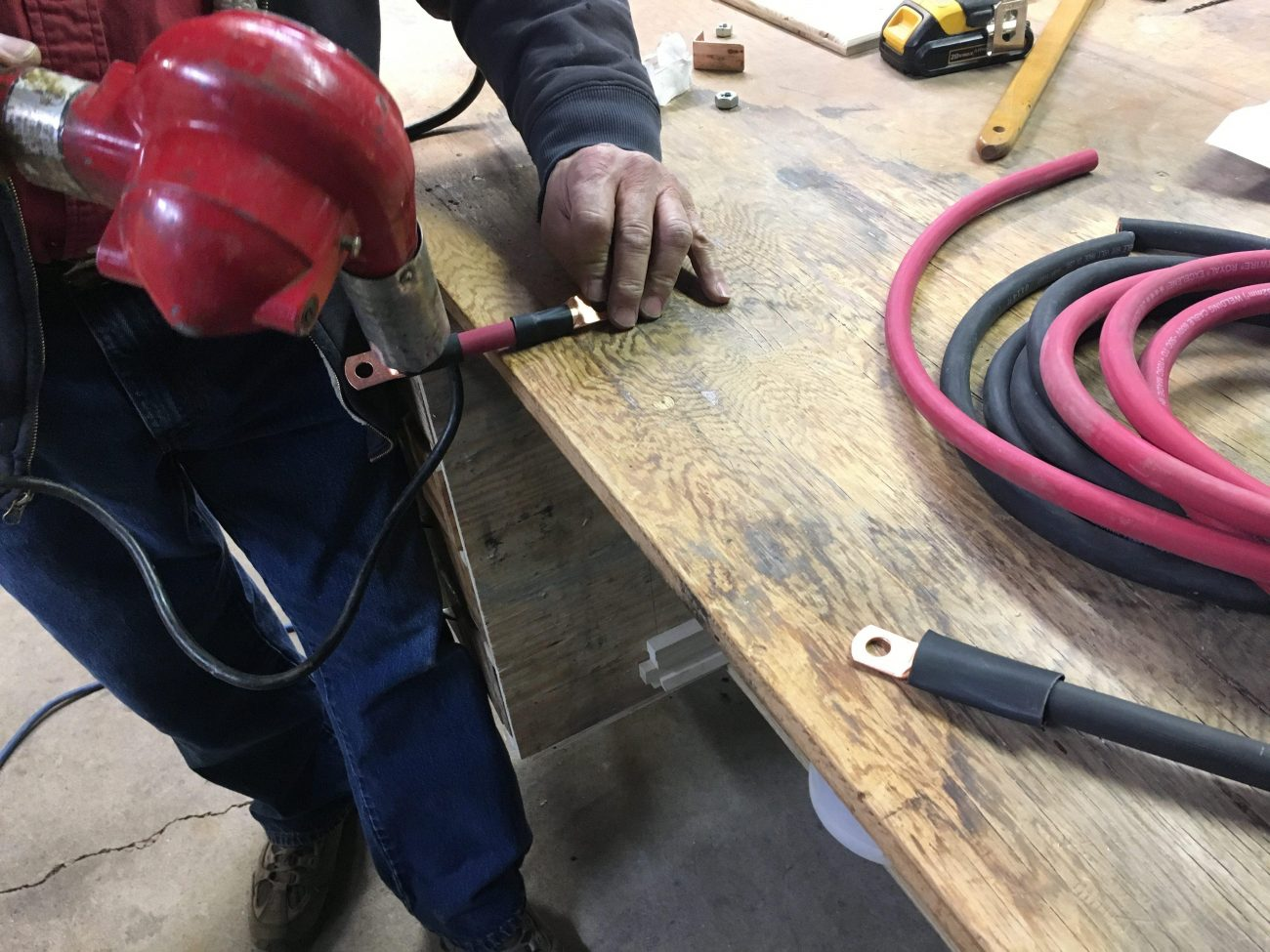 Creating custom wires with welding wire, copper lugs, and heat shrink.