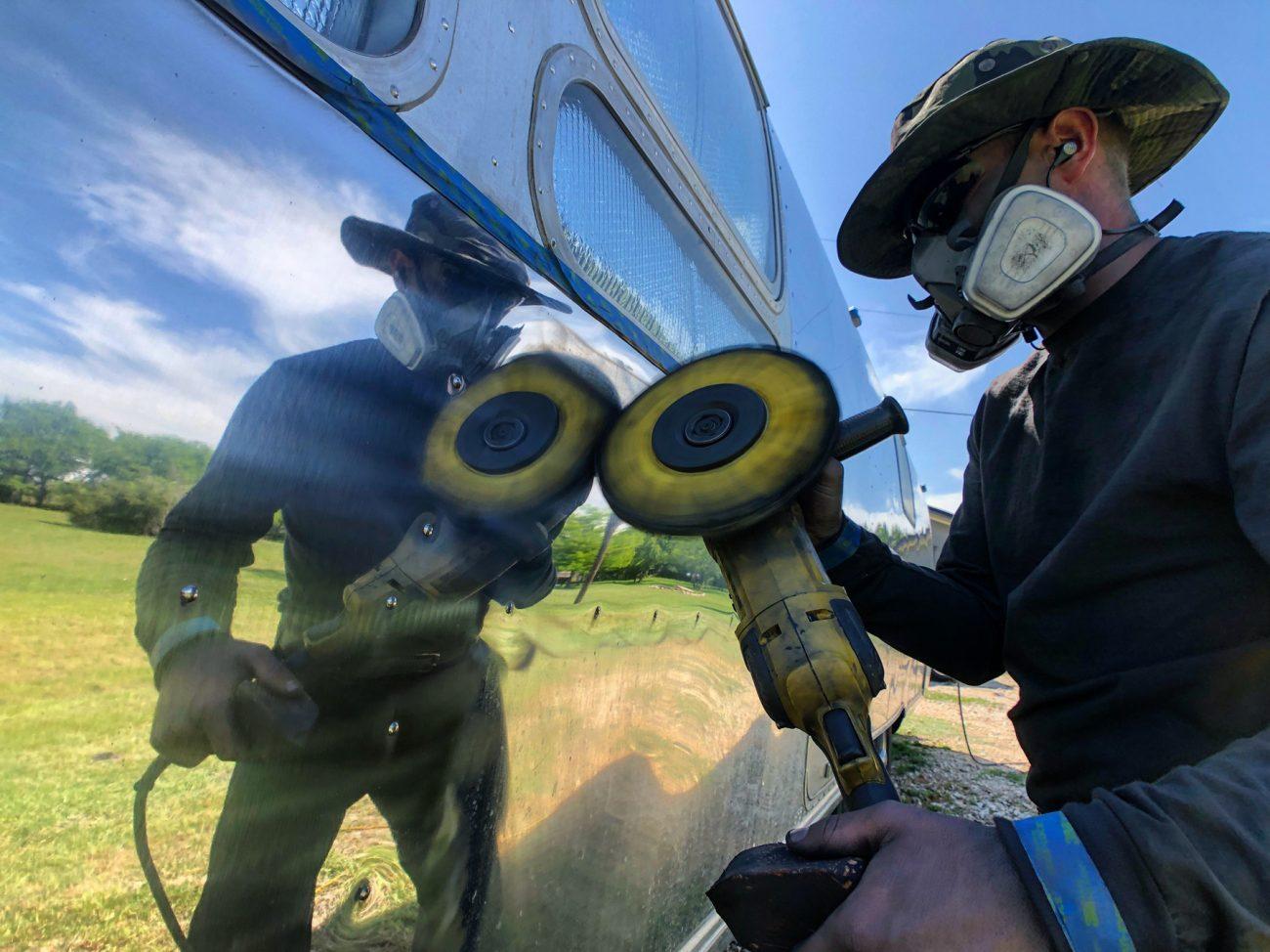Man reflected polishing Airstream