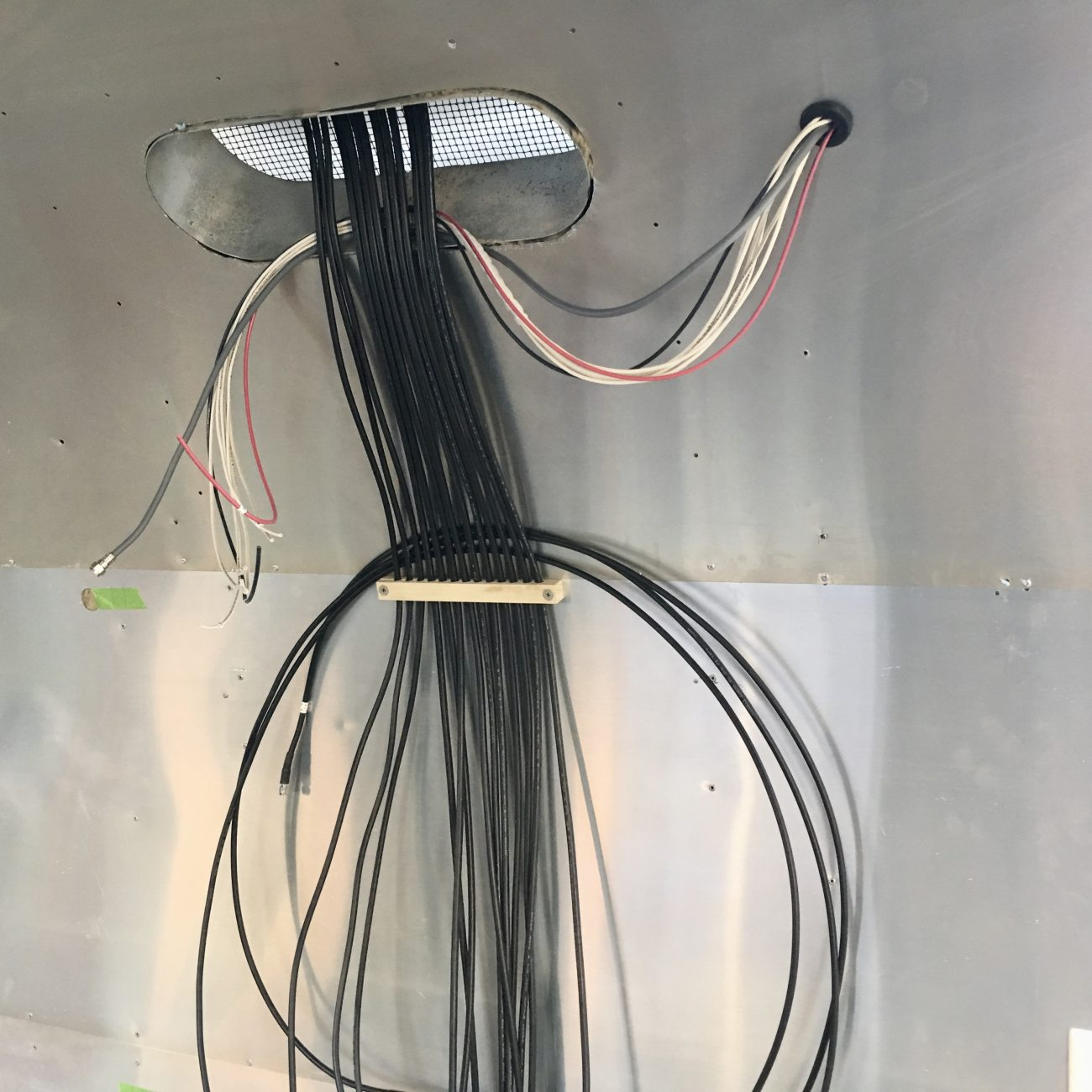Wires coming through refrigerator vent.
