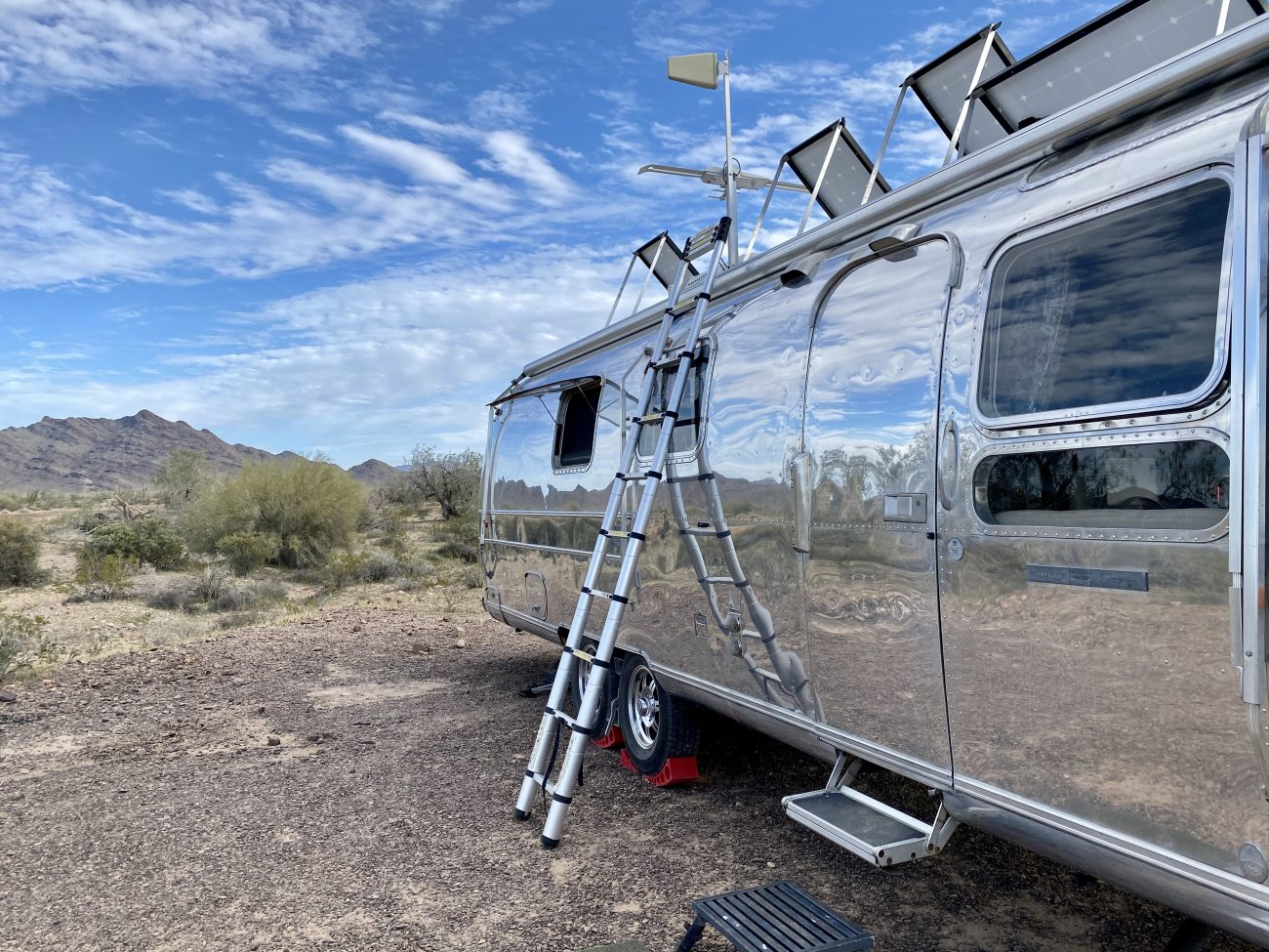Tilted solar panels on a renovated vintage Airstream.