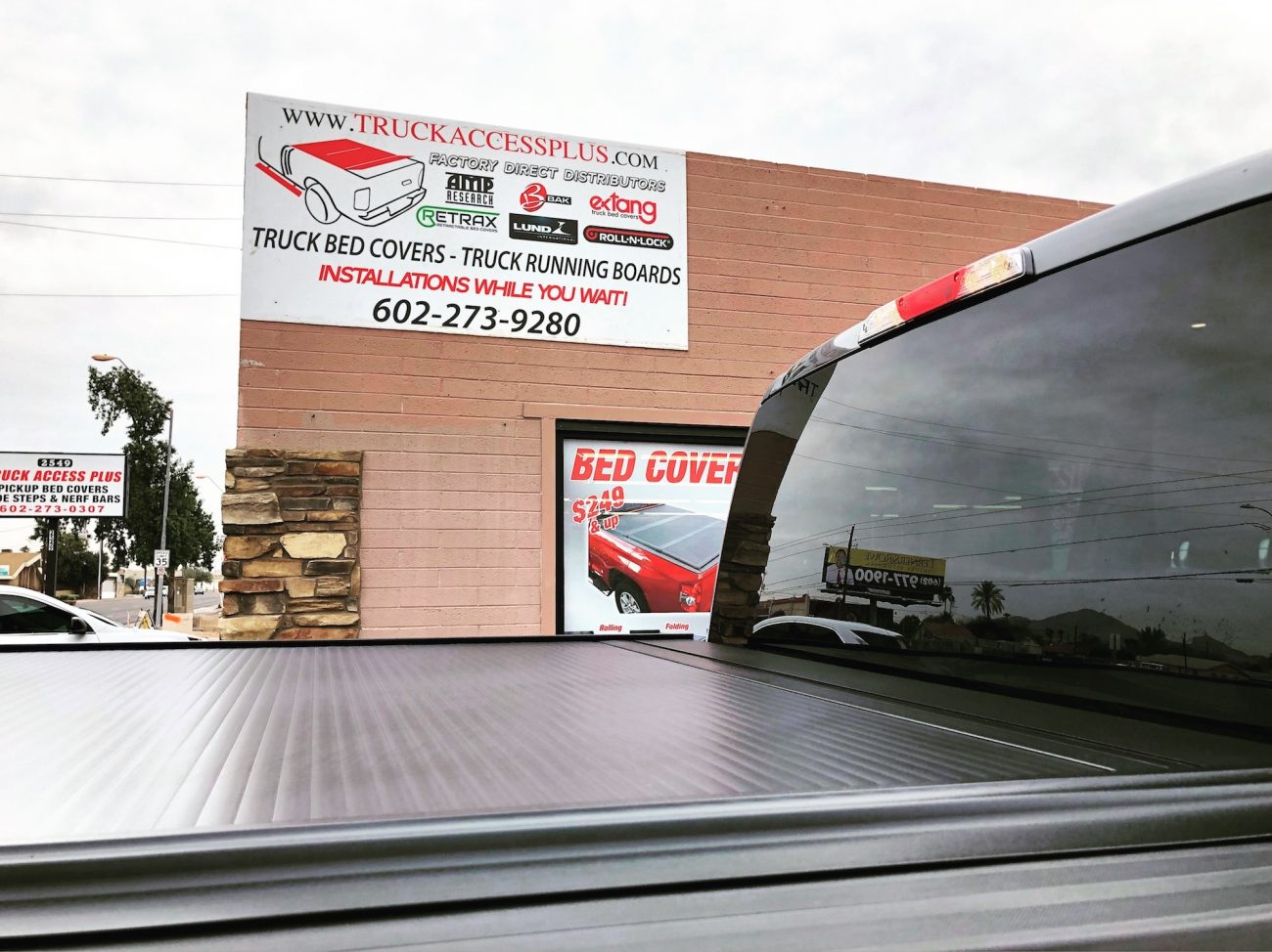 Retrax Cover on Truck in front of Truck Accessories Plus Building