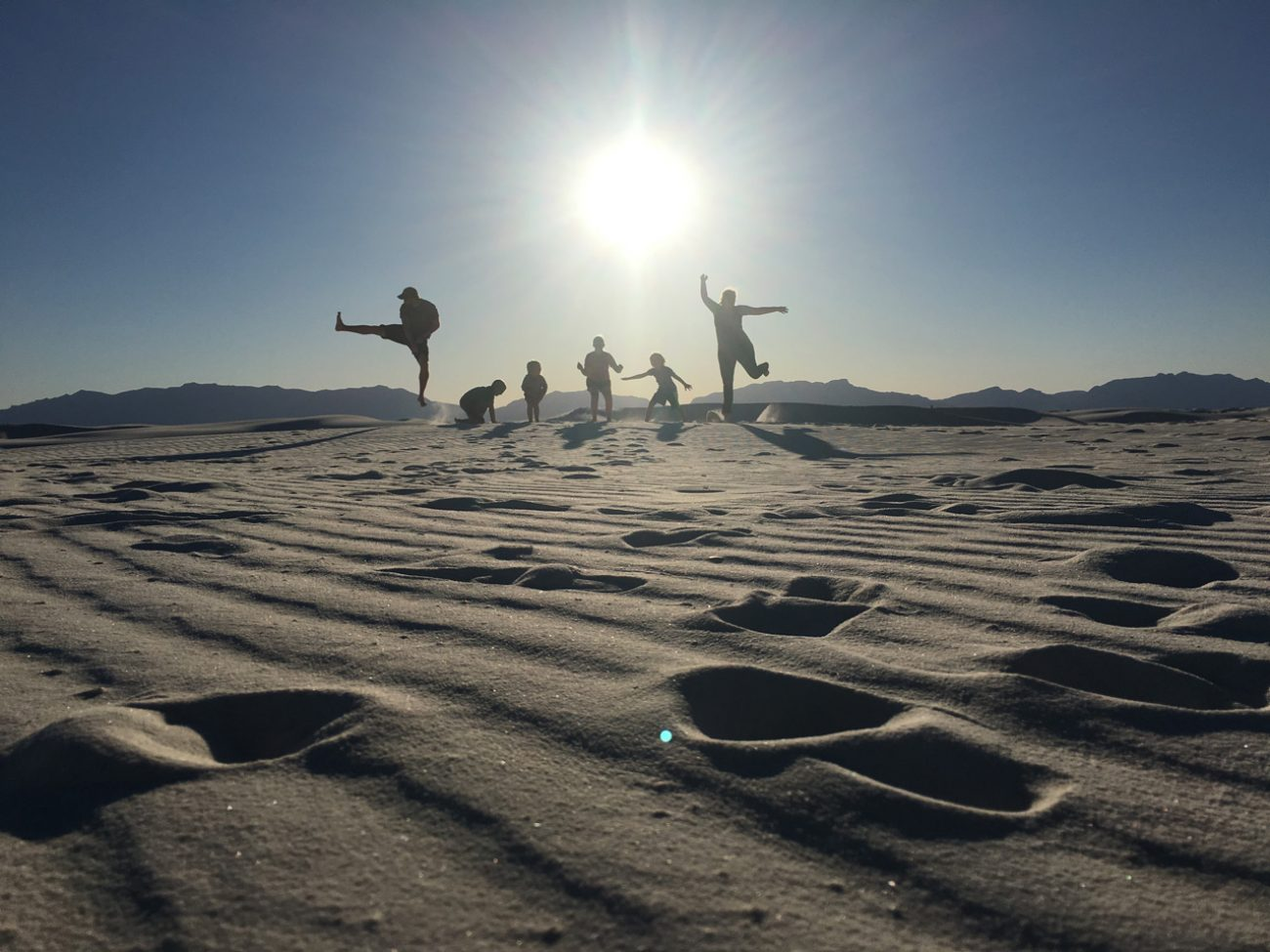 Us jumping at white sands