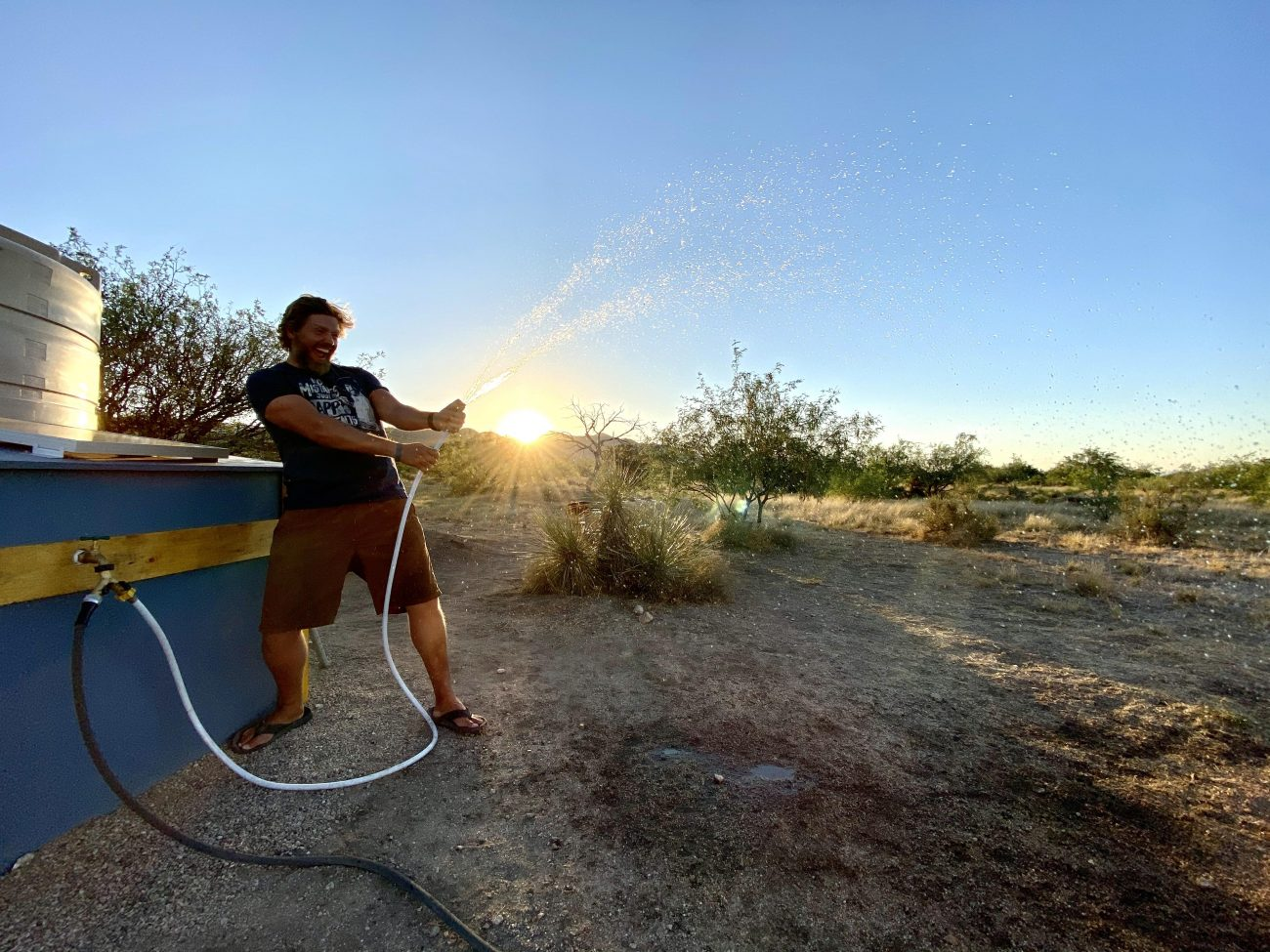 Spraying pressurized water off-grid at sunset.