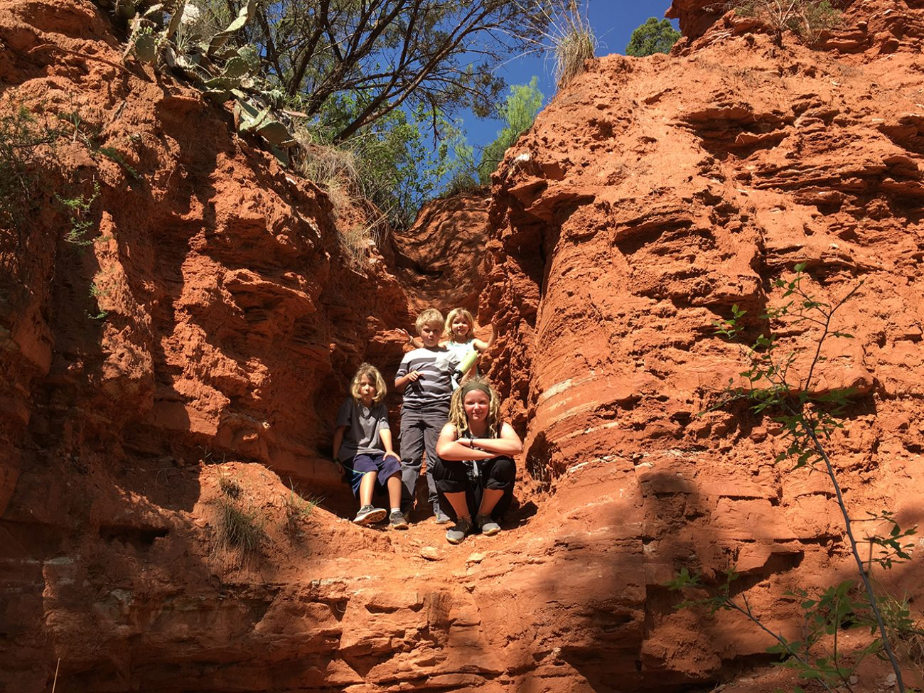 Kids In The Red Rocks On Hike